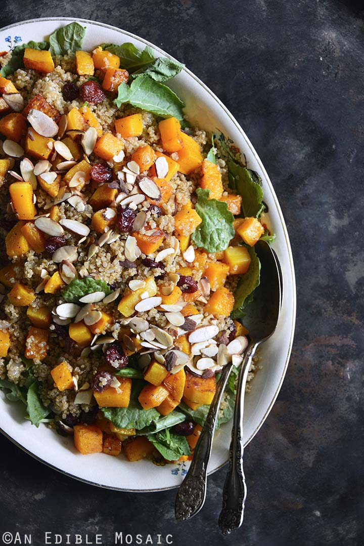 Sweet and Savory Quinoa Pilaf with Cranberries, Roasted Butternut Squash, and Toasted Almonds on Metal Tray Vertical Orientation