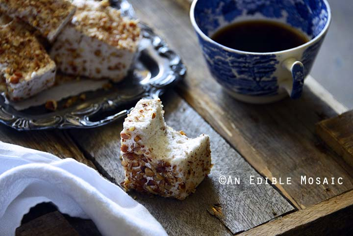 Vanilla Bean and Maple Toasted Pecan Marshmallows on Metal Tray on Wooden Table with Bite