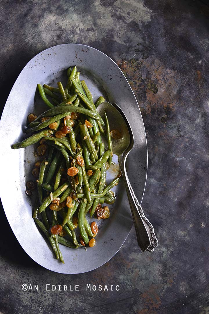 Green Beans with Garlic and Golden Raisins on Metal Tray