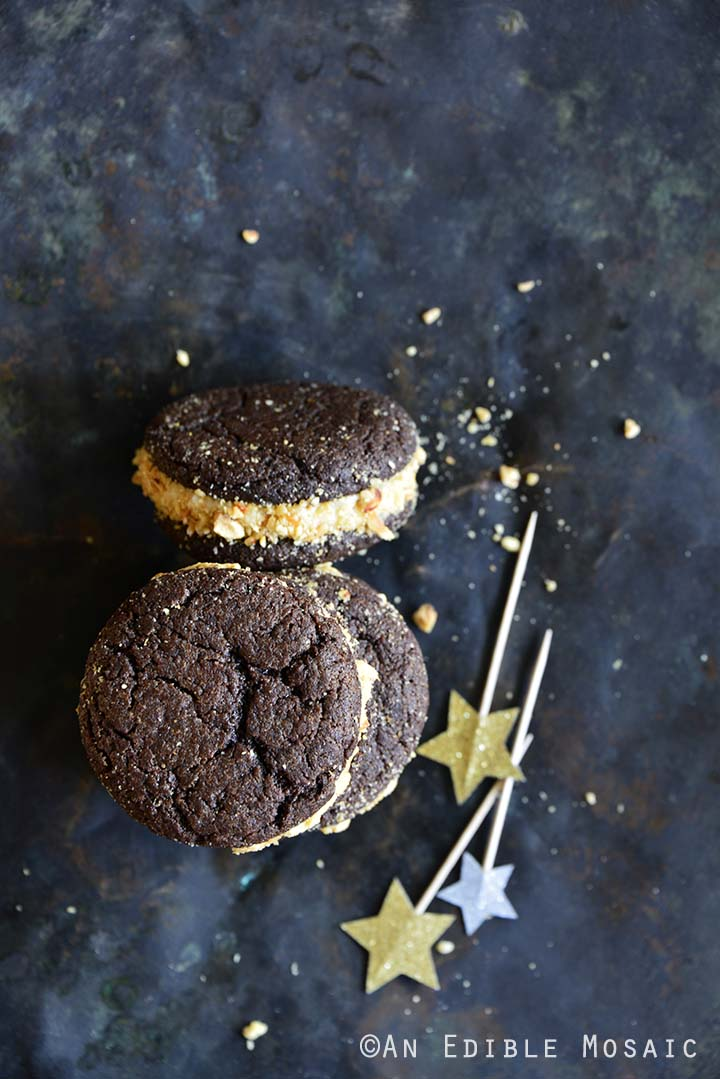 Chocolate Whoopie Pies with Maple Brown Butter Frosting and Hazelnut Caramel Crunch on Metal Tray