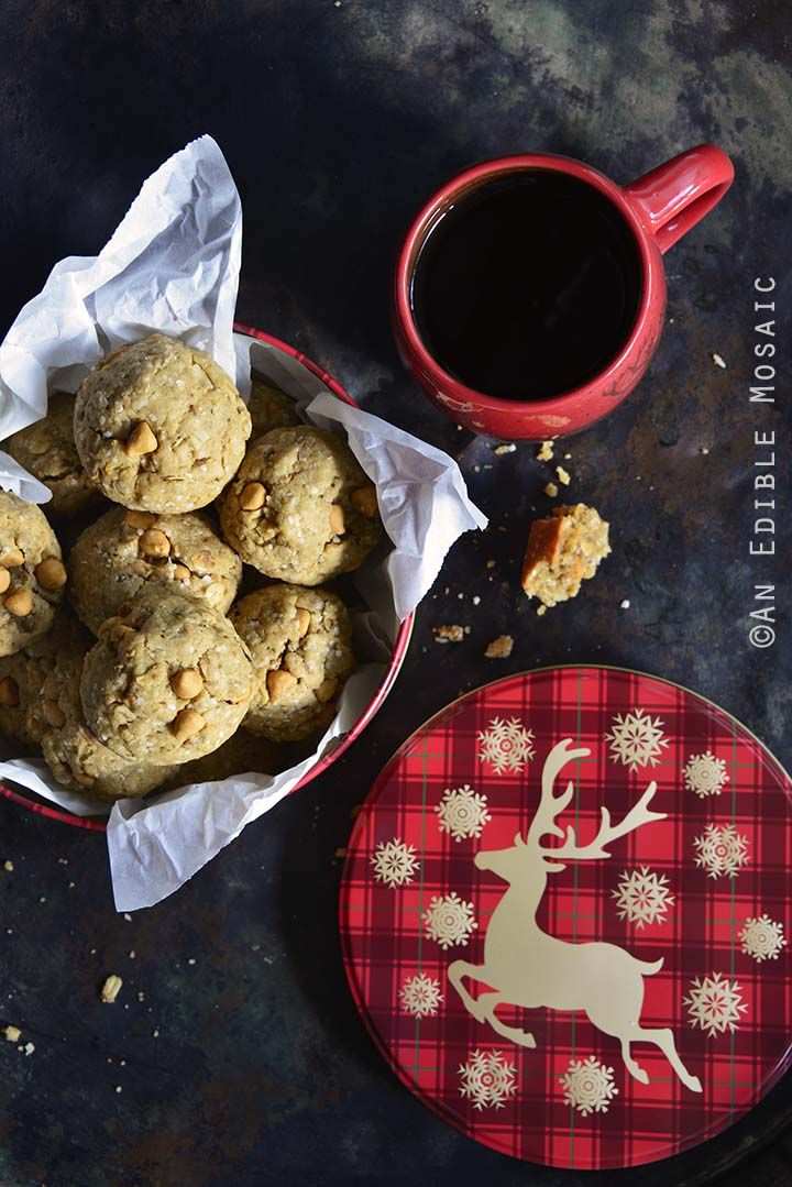 Coconut Butterscotch Granola Cookies with Festive Cookie Tin and Red Coffee Mug