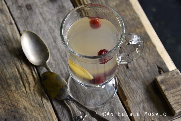 Glass of Honey-Apple Cranberry Ginger Tisane