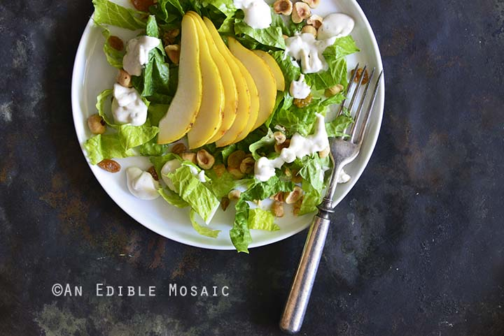 The Best Creamy Blue Cheese Dressing on Pear Hazelnut Salad Close Up