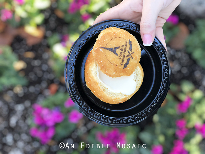 Warm Creamy Brie in a Housemade Bread Bowl with Flowers in Background at Epcot