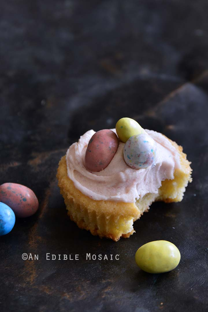 Partially Eaten Robin Eggs Vanilla Sugar Cookie Cup with Strawberry White Chocolate Ganache