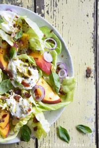 Burrata Peach Salad with Butter Lettuce, Basil, and Pistachio on Yellow Wooden Table