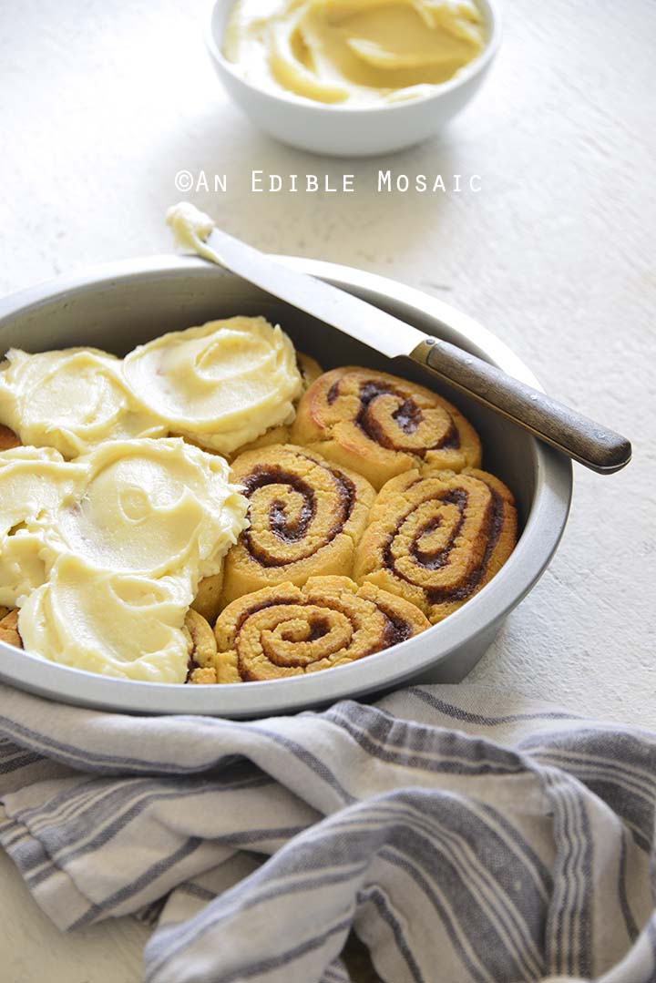 Best Low Carb Cinnamon Rolls Recipe in Pan with Blue and Gray Linen on White Table