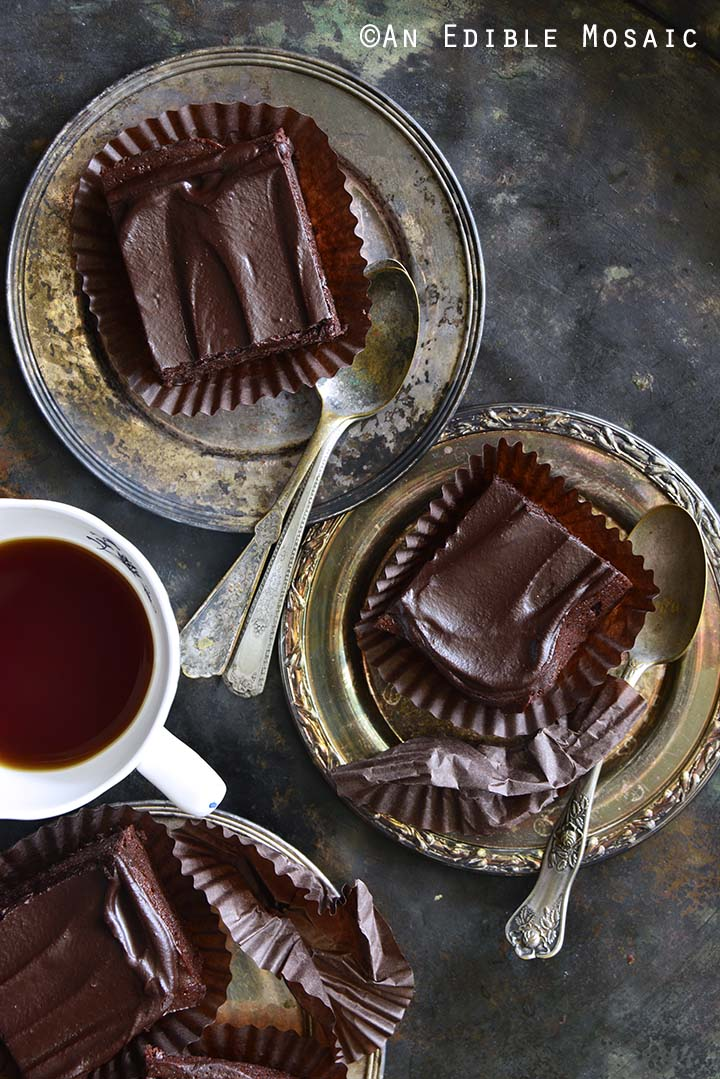 Slices of Fudgy Guinness Brownies with Dark Chocolate Ganache Recipe on Silver Trays with Vintage Spoons