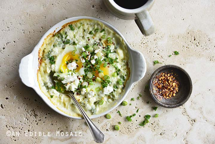 Herbed Eggs Baked in Cream with Feta with Crushed Red Pepper Flakes Garnish