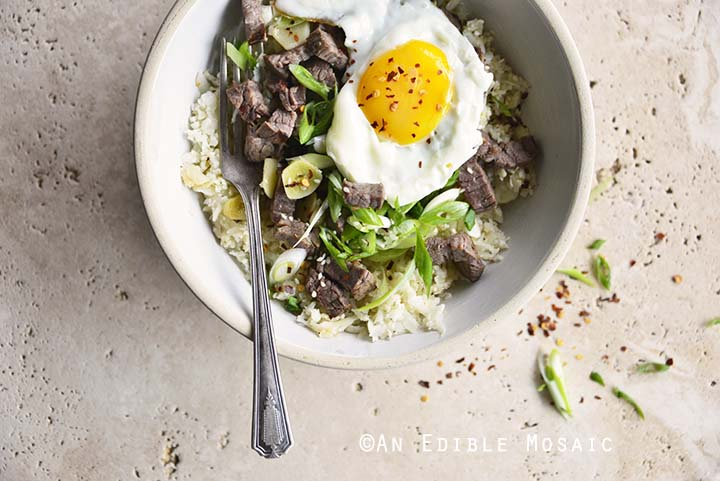 Close Up of Low Carb Chili Garlic Steak Rice Bowl with Fried Egg on Top