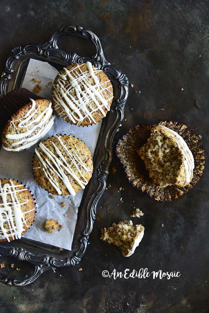 Chocolate Orange Muffins Recipe on Vintage Metal Tray with One Muffin Partially Eaten