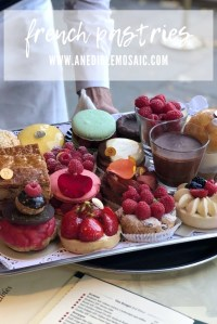 Waiter Holding a Tray of French Pastries