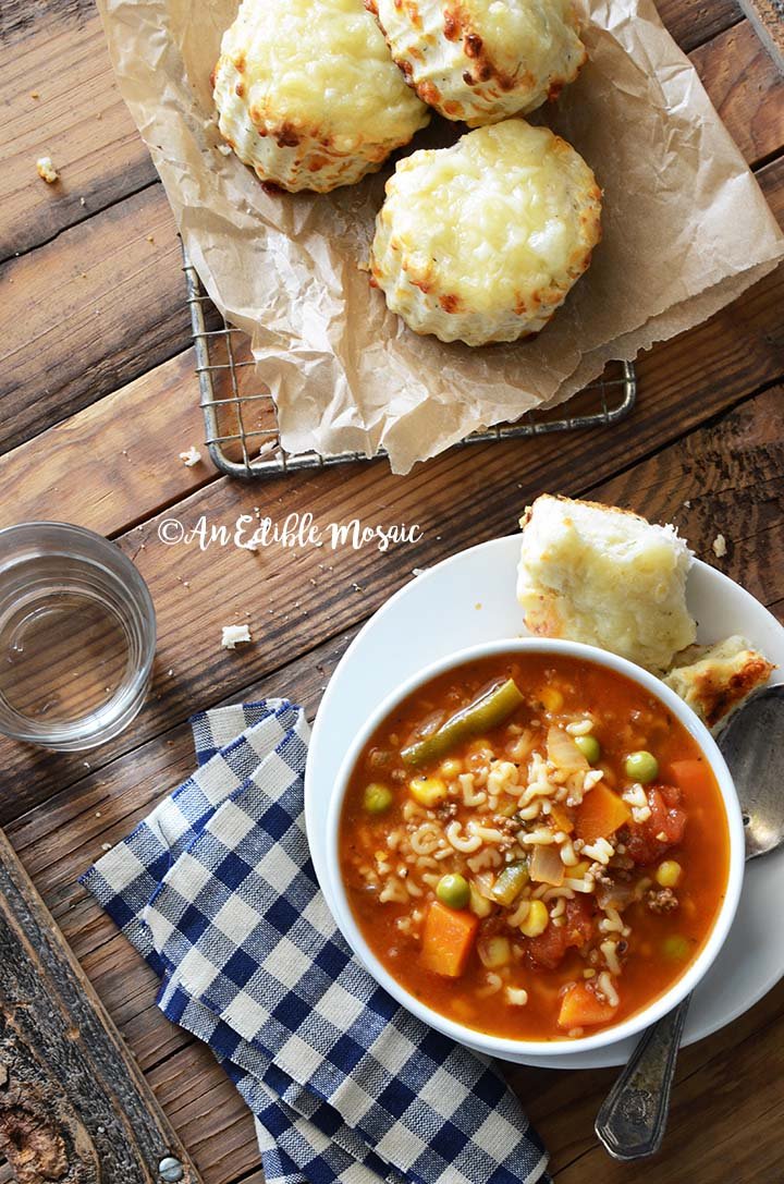 Vegetable Beef Alphabet Soup on Wooden Table with Savory Scones