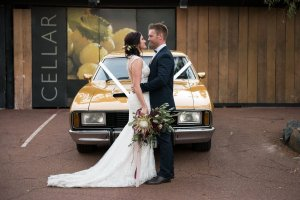 Bride and groom and vintage car