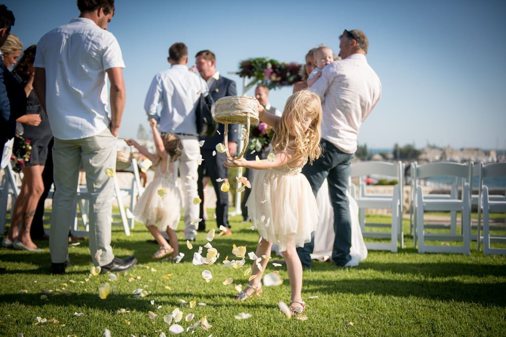 flower girl emptying the basket