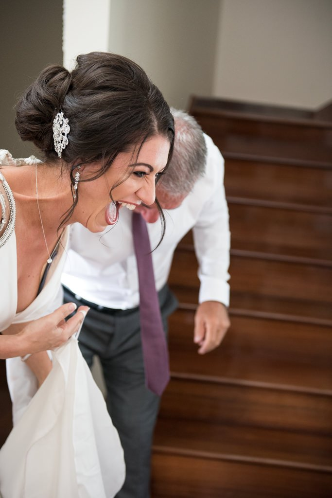 bride and her dad laughing crying