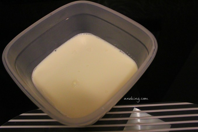 2. Place a cup of milk into a microwavable container.