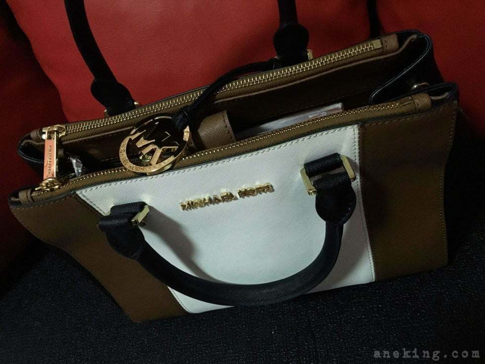 brown and white Michael Kors bag