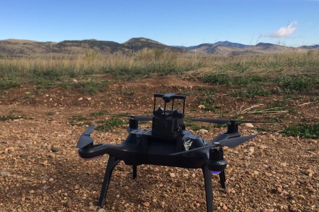the TriSonica Mini sits atop a drone in the Colorado Foothills