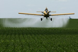 Applying agricultural spray. (Bryon Houlgrave/The Globe Gazette)