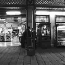 A young couple outside the arcade at Santa Monica Pier