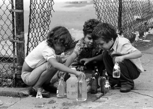 Kids playing with water from hydrant, Lower East Side, 1978