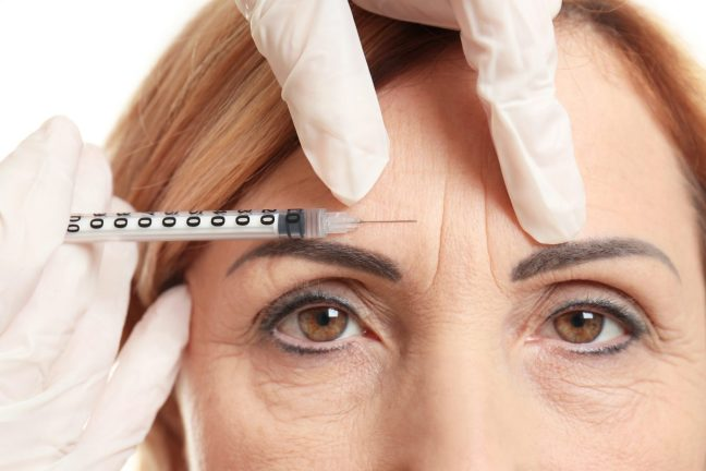 Lady getting botox injection