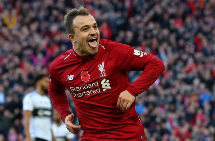 LIVERPOOL, ENGLAND - NOVEMBER 11: Xherdan Shaqiri of Liverpool celebrates after scoring his team's second goal during the Premier League match between Liverpool FC and Fulham FC at Anfield on November 11, 2018 in Liverpool, United Kingdom.