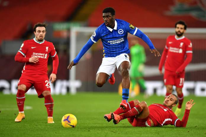 LIVERPOOL, ENGLAND - FEBRUARY 03: Yves Bissouma of Brighton and Hove Albion is challenged by Thiago Alcantara of Liverpool as Xherdan Shaqiri of Liverpool looks on during the Premier League match between Liverpool and Brighton & Hove Albion at Anfield on February 03, 2021 in Liverpool, England.
