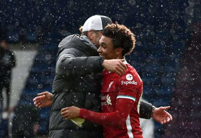 WEST BROMWICH, ENGLAND - MAY 16: Jurgen Klopp, Manager of Liverpool celebrates victory with Trent Alexander-Arnold of Liverpool following the Premier League match between West Bromwich Albion and Liverpool at The Hawthorns on May 16, 2021 in West Bromwich, England.