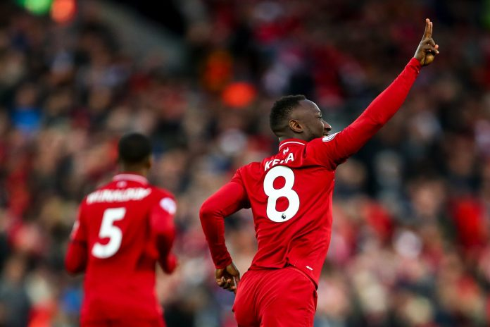 LIVERPOOL, ENGLAND - APRIL 26: Naby Keita of Liverpool celebrates after scoring a goal to make it 1-0 during the Premier League match between Liverpool FC and Huddersfield Town at Anfield on April 26, 2019 in Liverpool, United Kingdom.