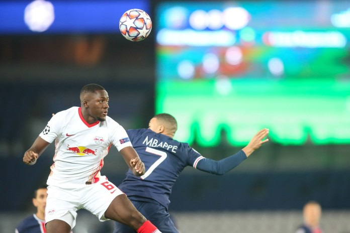 Leipzig's Ibrahima Konate jumps for the ball with PSG's Kylian Mbappe (background) during the UEFA Champions League Group H second-leg football match between Paris Saint-Germain (PSG) and RB Leipzig at the Parc des Princes stadium in Paris, FRANCE . Paris Saint-Germain's French forward Kylian Mbappe (L) vies for the ball with Leipzig's French defender Ibrahima Konate during the UEFA Champions League Group H second-leg football match between Paris Saint-Germain (PSG) and RB Leipzig at the Parc des Princes stadium in Paris on November 24, 2020.