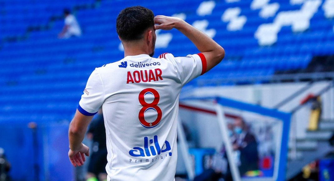 LYON, FRANCE - MAY 08: Houssem Aouar #8 of Olympique Lyonnais celebrates his goal during the Ligue 1 match between Olympique Lyonnais and FC Lorient at Groupama Stadium on May 8, 2021 in Lyon, France.