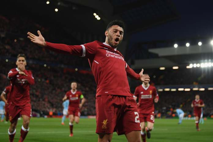 LIVERPOOL, ENGLAND - APRIL 04: Alex Oxlade-Chamberlain of Liverpool celebrates after scoring his sides second goal during the UEFA Champions League Quarter Final Leg One match between Liverpool and Manchester City at Anfield on April 4, 2018 in Liverpool, England.