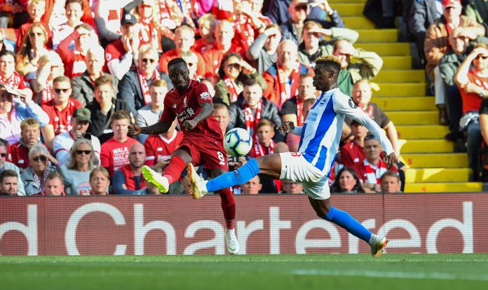 LIVERPOOL, ENGLAND - AUGUST 25: (THE SUN OUT, THE SUN ON SUNDAY OUT) Naby Keita of Liverpool competes with Yves Bissouma of Brighton & Hove Albion during the Premier League match between Liverpool FC and Brighton & Hove Albion at Anfield on August 25, 2018 in Liverpool, United Kingdom.