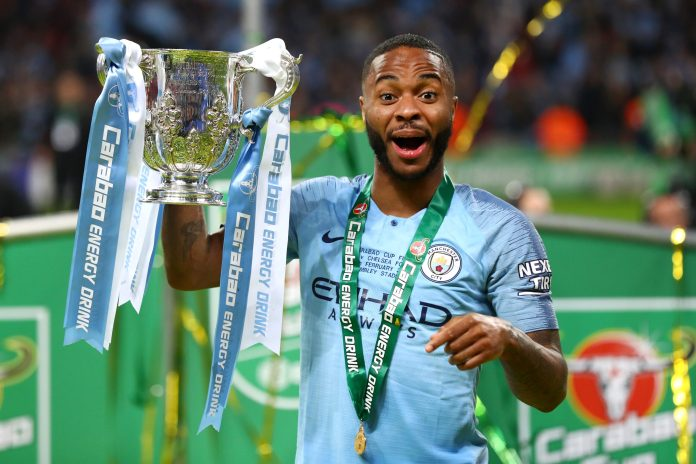 LONDON, ENGLAND - FEBRUARY 24: Raheem Sterling of Manchester City celebrates with the trophy after winning the Carabao Cup Final between Chelsea and Manchester City at Wembley Stadium on February 24, 2019 in London, England.