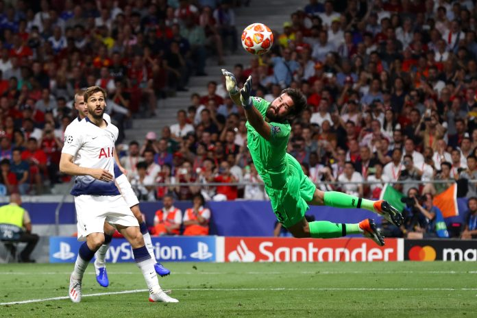 MADRID, SPAIN - JUNE 01: Alisson of Liverpool makes a save during the UEFA Champions League Final between Tottenham Hotspur and Liverpool at Estadio Wanda Metropolitano on June 01, 2019 in Madrid, Spain.