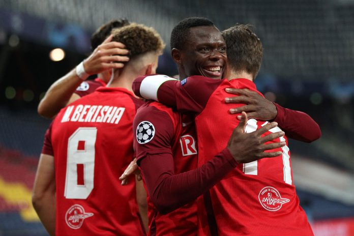 SALZBURG, AUSTRIA - SEPTEMBER 30: Patson Daka of RB Salzburg celebrates with teammate Andreas Ulmer after scoring his sides third goal during the UEFA Champions League Play-Off second leg match between RB Salzburg and Maccabi Tel-Aviv at Red Bull Arena on September 30, 2020 in Salzburg, Austria.