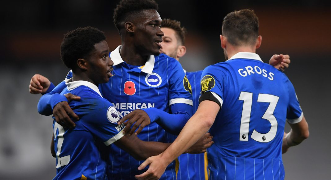 LONDON, ENGLAND - NOVEMBER 01: Tariq Lamptey of Brighton and Hove Albion celebrates with teammates Yves Bissouma and Pascal Gross after scoring his sides first goal during the Premier League match between Tottenham Hotspur and Brighton & Hove Albion at Tottenham Hotspur Stadium on November 01, 2020 in London, England.