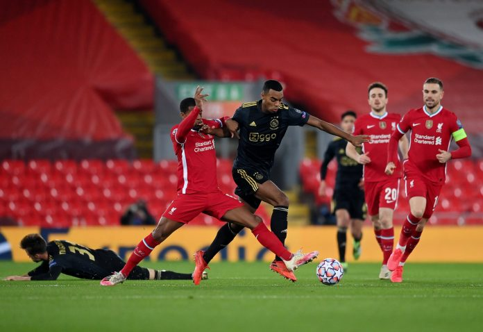 LIVERPOOL, ENGLAND - DECEMBER 01: Ryan Gravenberch of Ajax is challenged by Georginio Wijnaldum of Liverpool during the UEFA Champions League Group D stage match between Liverpool FC and Ajax Amsterdam at Anfield on December 01, 2020 in Liverpool, England.