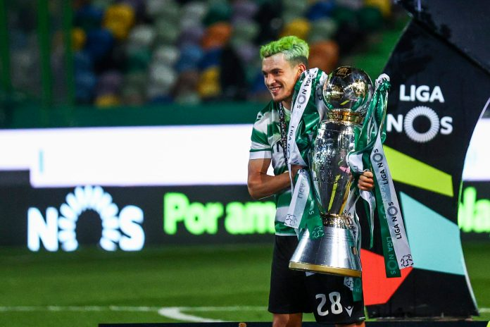 LISBON, PORTUGAL - MAY 11: Pedro Goncalves of Sporting CP with the Portuguese League Champion Trophy after the match of the Liga NOS match between Sporting CP and Boavista FC at Estadio Jose Alvalade on May 11, 2021 in Lisbon, Portugal.