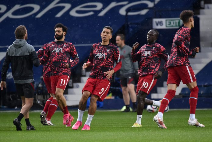 WEST BROMWICH, ENGLAND - MAY 16: (L - R) Mohamed Salah, Roberto Firmino and Sadio Mane of Liverpool warm up prior to the Premier League match between West Bromwich Albion and Liverpool at The Hawthorns on May 16, 2021 in West Bromwich, England.