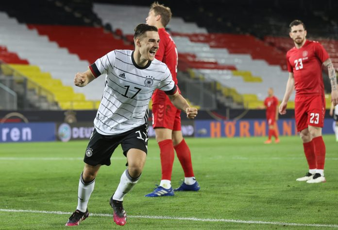 INNSBRUCK, AUSTRIA - JUNE 02: Florian Neuhaus of Germany celebrates after scoring their side's first goal during the international friendly match between Germany and Denmark at Tivoli Stadion on June 02, 2021 in Innsbruck, Austria.