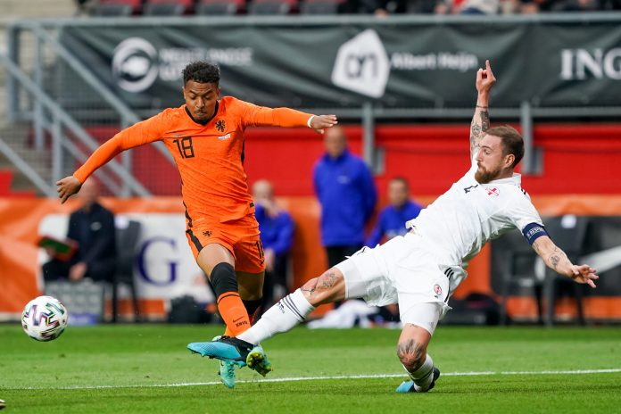 ENSCHEDE, NETHERLANDS - JUNE 6: Donyell Malen of the Netherlands and Guram Kashia of Georgia during the International Friendly match between Netherlands and Georgia at FC Twente Stadion on June 6, 2021 in Enschede, Netherlands.