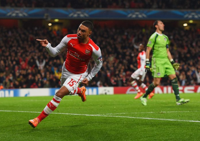 LONDON, ENGLAND - NOVEMBER 04: Despair for Silvio Proto of Anderlecht (R) as Alex Oxlade-Chamberlain of Arsenal celebrates as he scores their third goal during the UEFA Champions League Group D match between Arsenal FC and RSC Anderlecht at Emirates Stadium on November 4, 2014 in London, United Kingdom.