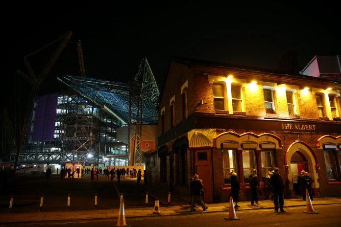 LIVERPOOL, ENGLAND - JANUARY 20: Supporters make their way to the ground as construction work continues prior to The Emirates FA Cup Third Round Replay match between Liverpool and Exeter City at Anfield on January 20, 2016 in Liverpool, England.