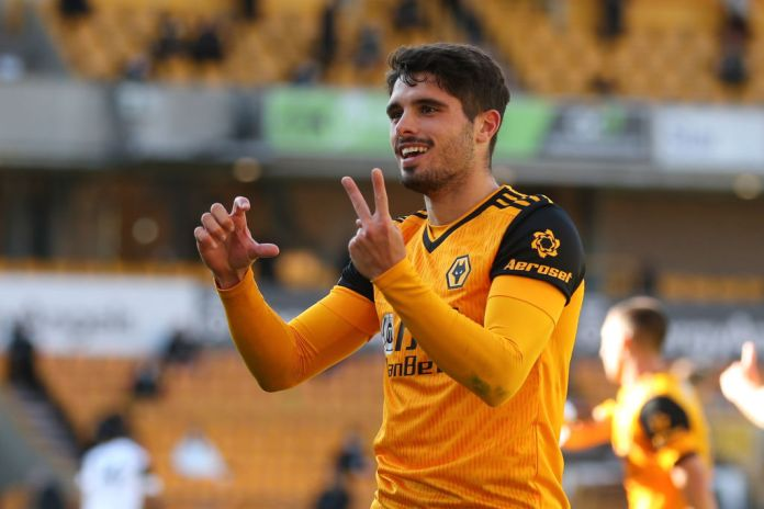 WOLVERHAMPTON, ENGLAND - OCTOBER 04: Pedro Neto of Wolverhampton Wanderers celebrates after scoring a goal to make it 1-0 during the Premier League match between Wolverhampton Wanderers and Fulham at Molineux on October 4, 2020 in Wolverhampton, United Kingdom. Sporting stadiums around the UK remain under strict restrictions due to the Coronavirus Pandemic as Government social distancing laws prohibit fans inside venues resulting in games being played behind closed doors. (Photo by James Williamson - AMA/Getty Images)