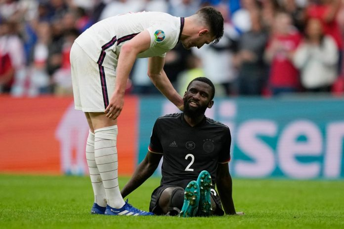 TOPSHOT - England's midfielder Declan Rice talks with Germany's defender Antonio Ruediger at the end of the UEFA EURO 2020 round of 16 football match between England and Germany at Wembley Stadium in London on June 29, 2021.