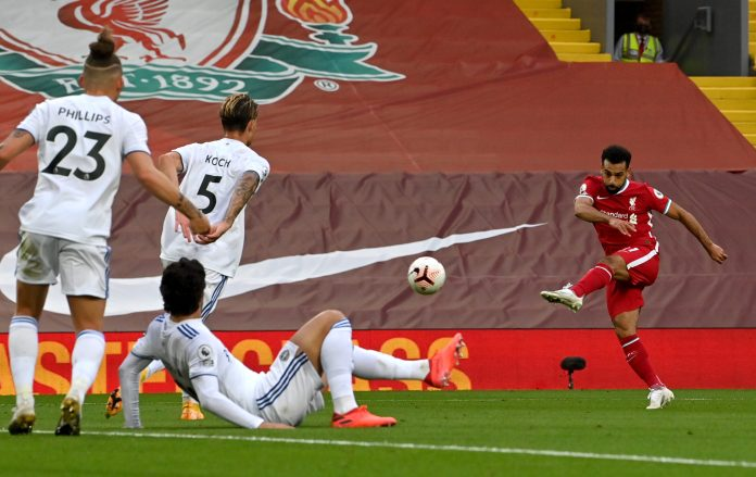 LIVERPOOL, ENGLAND - SEPTEMBER 12: Mohamed Salah of Liverpool scores his team's third goal during the Premier League match between Liverpool and Leeds United at Anfield on September 12, 2020 in Liverpool, England.