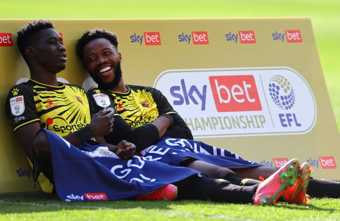 WATFORD, ENGLAND - APRIL 24: Ismaila Sarr and Nathaniel Chalobah of Watford look on at the final whistle as they are promoted to the Premier League following the Sky Bet Championship match between Watford and Millwall at Vicarage Road on April 24, 2021 in Watford, England.